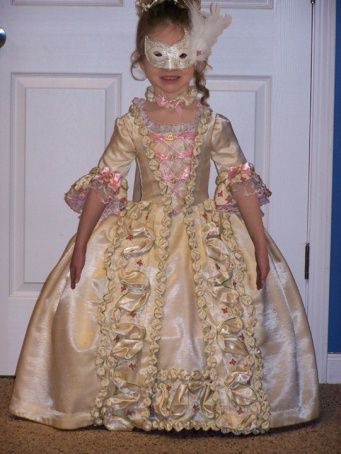 Handmade Halloween Costume.  sounds like it was expensive (materials) and very time-consuming, but I may get some great ideas.  No tutorial or pattern in link.