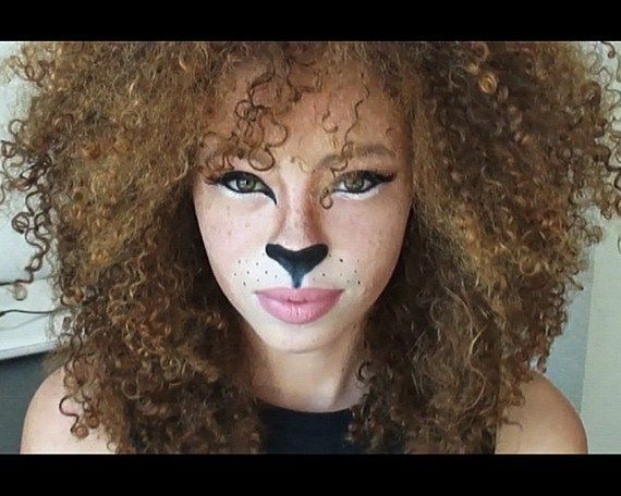Lioness makeup look. Great with the big and curly hair!