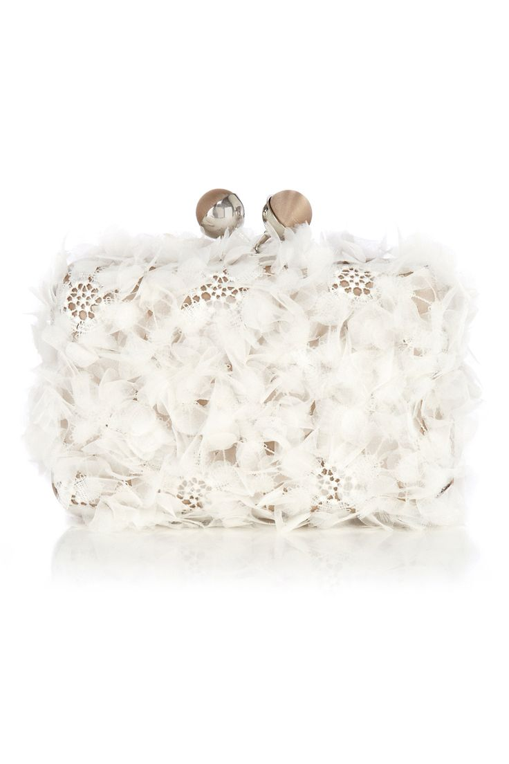 Covered in a romantic lace this beautiful box clutch is perfect for carrying your coveted essentials. The Desphina Clutch is adorned in delicately attached voile ruffles creating an eye catching textured look. Closed with two satin covered ball clasps this bag is fully lined for a luxe look. For added versatility the bag includes a detachable silver metal toned chain strap with a 28cm drop.
