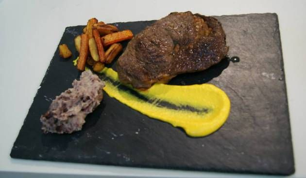 rib eye Aberdeen Angus, Stornoway black pudding, root vegetable chips and creamed carrot