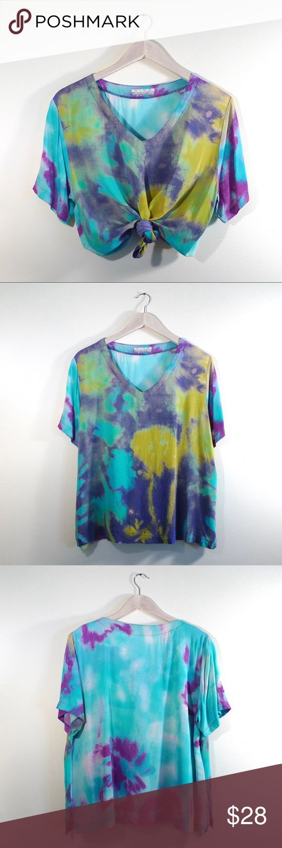 90s Tie Dye Loose Rayon Summer Festival Top The photos really don't do the colors justice! Because....  The purple on the sleeve is more of a vibrant pink! BUT either way, this top is so much fun.  Super unique and definitely one-of-a-kind ; )  I really love the beachy summer vibe to this piece. 💦🐠🌴  Somewhat oversized depending on your frame. I'd list this as a loose Medium.  Will be updating listing with exact measurements asap.  Condition: Excellent Vintage Tops