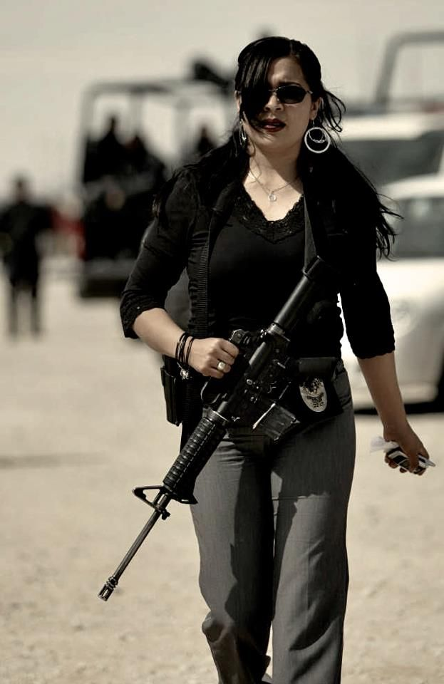 Female police officer in Ciudad Juarez, Mexico. Can I just say how much of a bad ass she is? I adore her and I have never even met her!