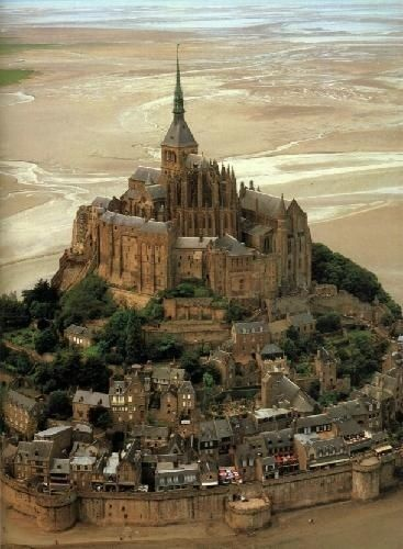 Stunning Mont St. Michel, France. The structural composition of the town exemplifies the feudal society that constructed it: On top, God, the abbey and monastery; below this, the great halls; then stores and housing; and at the bottom, outside the walls, fishermen's and farmers' housing.