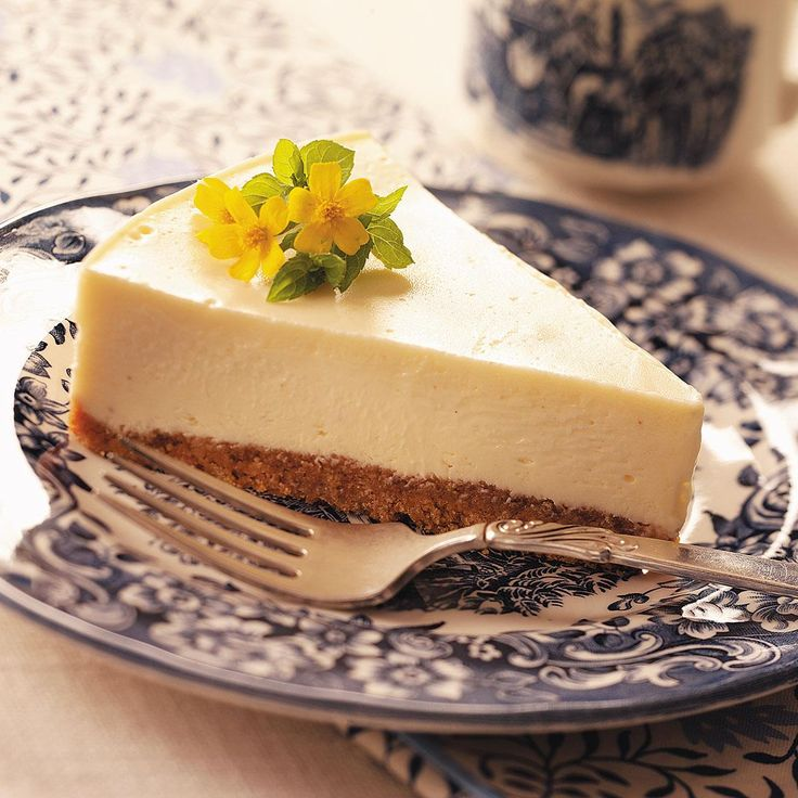 Eggnog Cheesecake Recipe -I make good use of extra eggnog by creating this luscious cheesecake. A bit of rum extract adds a special taste. —Kristen Grula, Hazleton, Pennsylvania