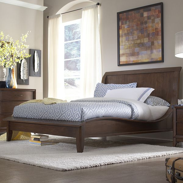 classic styles and modern shapes come together in this timeless queen bed curved lines and a low footboard make this bed the center of your bedroom