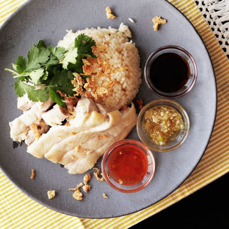 How to make Hainanese Chicken Rice.. Ingredients: 1 chicken thigh, 300 grams uncooked rice, 360 ml water, 10 cm piece green onion, coriander, fried onions, (seasoning), 15 grams ginger, thinly sliced, 1 tbsp soy sauce, 2 tsp powdered chicken bouillon, 1 tsp oil, 1 tsp salt, (soy sauce), 1 tbsp soy sauce, 1 tbsp oyster sauce, 1 tsp honey, (chili sauce), 2 tbsp sweet chili sauce, 1 tbsp fish sauce, 1 tbsp lemon juice, (ginger sauce), 2 tsp ginger, grated, 1 tbsp green onions, minced, 1 tbsp…