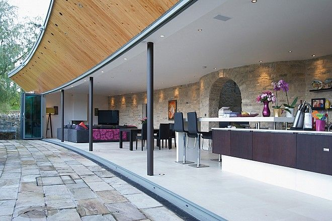 amazing over handing wooden facia and lovely flooring from sunfold.com - Folding sliding doors the SFK70 system with 18 panels