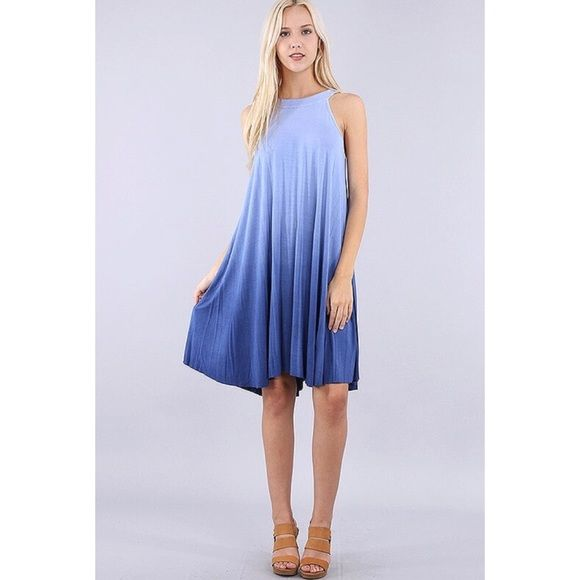 Cute flirty and oh so comfortable halter dress in blue ombré.  Be comfortable and trendy at the same time.  Great for easy styling and very flattering!    Loose fit.   Also available in gray and rose.     Sizes: S/M/L    96% Viscose, 4% Spandex     Made in USA!    Length: 40 in.