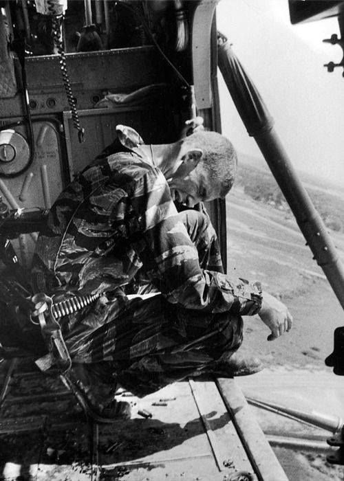 Vietnam War. During a mission aboard Yankee Papa 13 crew chief Lance Cpl. James Farley cries after having just witnessed the shooting of two crew mates one of them fatally.