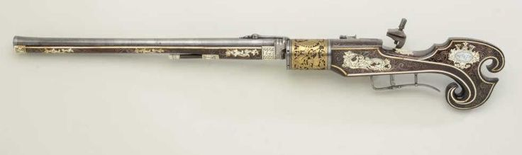 An ornate 6 shot wheel-lock revolving musket decorated with gold, silver, ivory, and bone. Originates from Russia, 16th century, possibly restored or added onto in the 18th or 19th century.