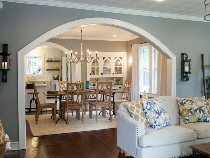 The transformation of the dining room is considerable – with dramatic improvements to the built-in cabinets, new window treatments and an impressive chandelier. Decorative iron sconces with pillar candles accentuate the newly enlarged archway.