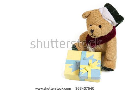 Cute small furry teddy bear toy sitting with two handmade paper gift boxes on isolated white background - background picture for wishing a happy birthday with birthday cards, or for valentines day