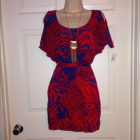 Red and Blue Printed Dress Beautiful and light. Red and blue open back dress with zebra and cheetah printed accents. Amazing condition. BCBGeneration Dresses Backless