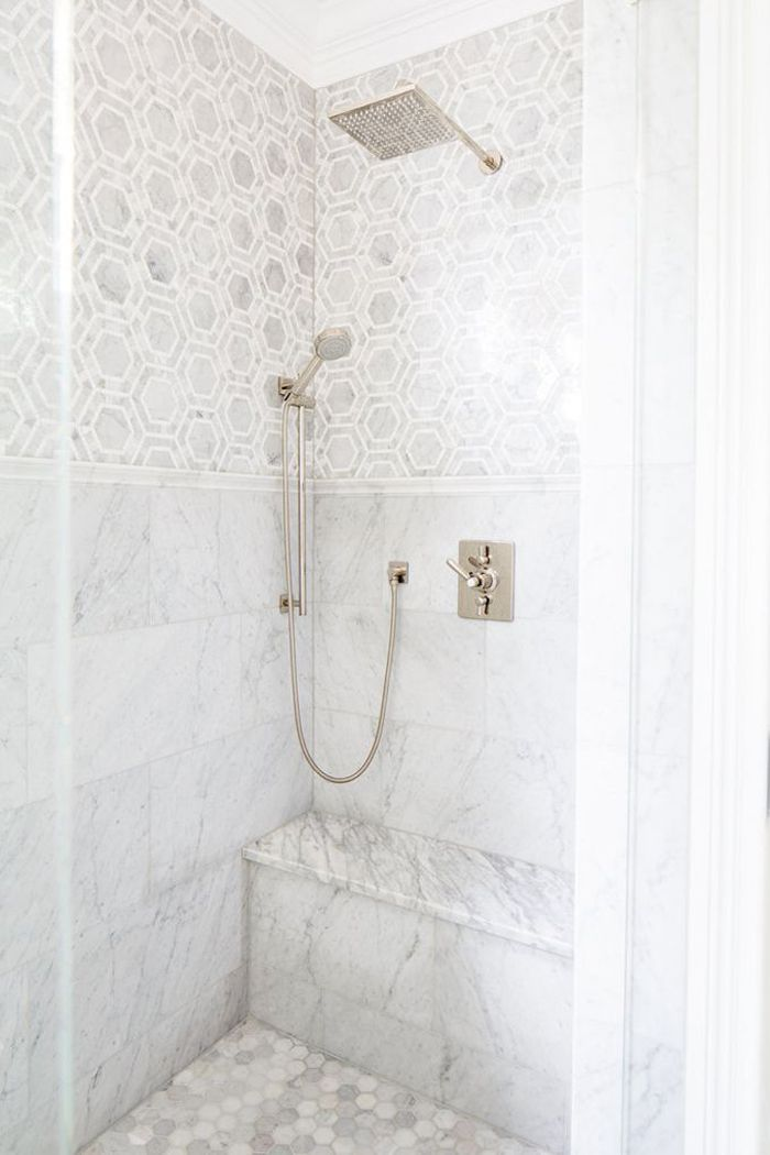 Marble tile heaven in a shower designed by Natalie Clayman Interior Design.