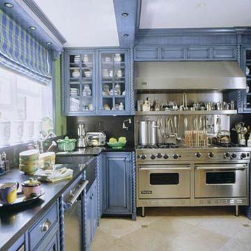 Love the blue cabinets, and I would be in heaven with that commercial stove! Designed by Pam O'Connell.