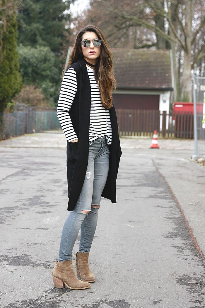 Stripes and a long black vest via Seeking Sunshine
