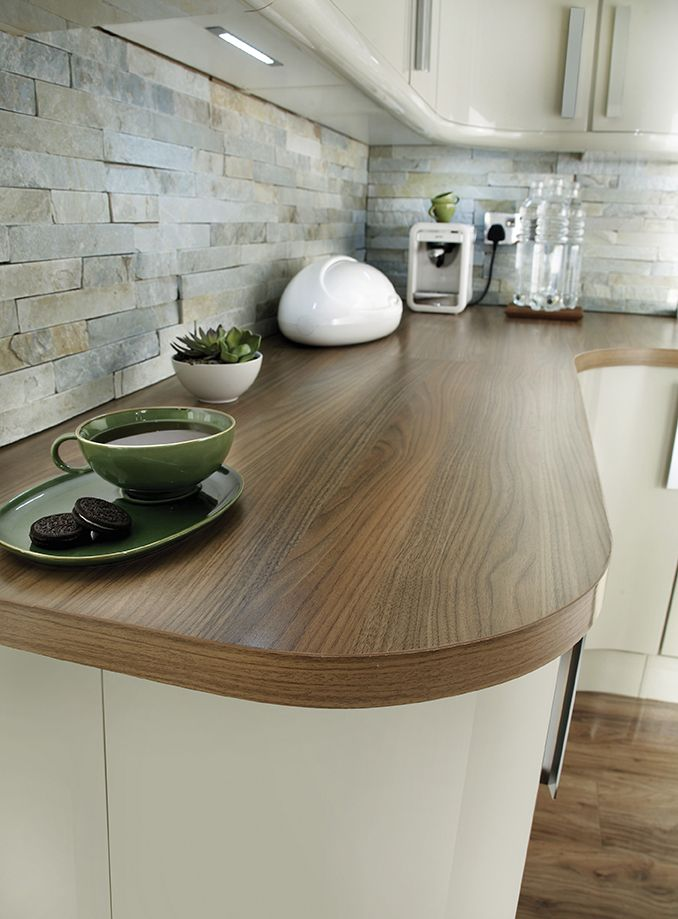 Our Glendevon flint kitchen looks beautiful with an American Pecan gloss worktop. Make your kitchen stand out by adding contrast. See more at Howdens.