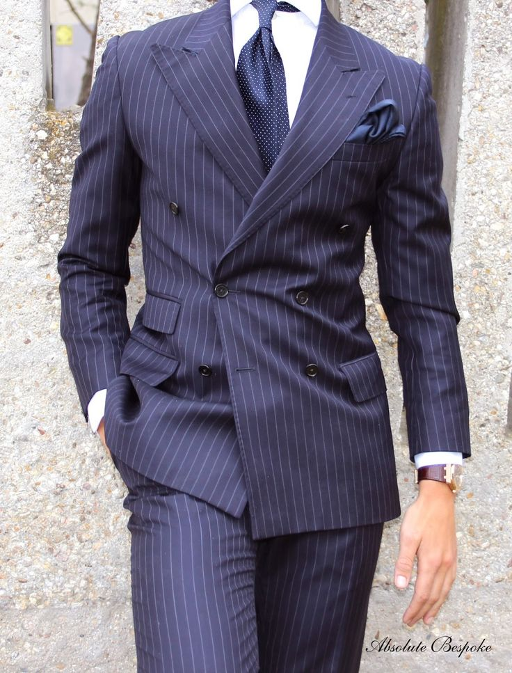 Double breasted pin-stripe navy suit with peaked lapels and ticket pocket. (1/3)