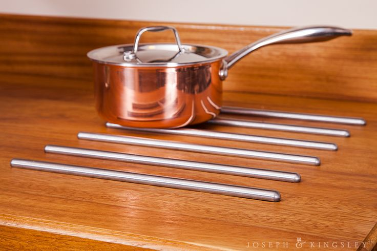 Stainless steel hotrods protect the beautiful wooden How to clean wooden kitchen worktops