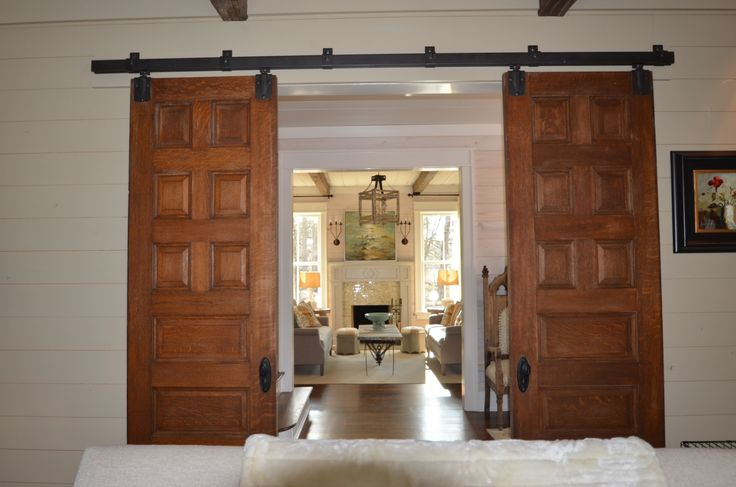 Looking from study to living room.  Reclaimed oak doors.