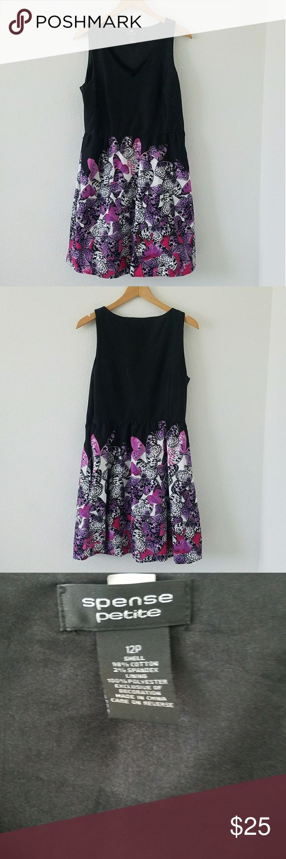 Gorgeous butterfly dress. This dress is cute for going out to a formal event. It complements a beautiful butterfly pattern that goes around the the bottom of dress. The bottom of the dress flares out beautifully. It also has two pockets on the sides.  The neckline is a v-neck.  There is a zipper on the side and belt loops on the waist.  Belt not included. I'm 5'3 so the length of the dress hits a little above the knee.  The dress is an overall good condition.  98% cotton 2% spandex size 12…