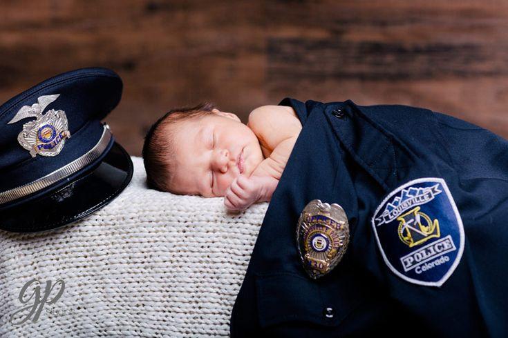Newborn photo using Dad's police officer uniform