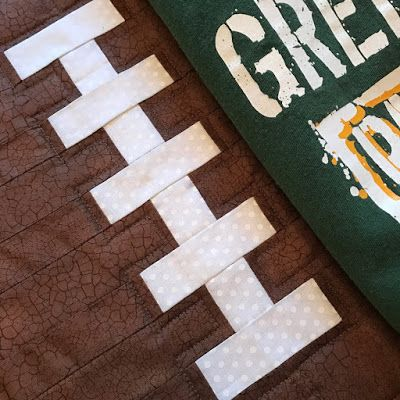 Packers football quilt! Love the laces with the top stitching around them...