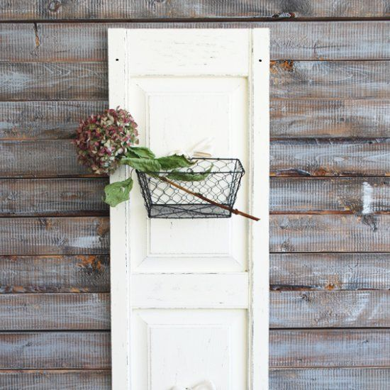 Turn an old plastic shutter door into rustic, chic home decor!