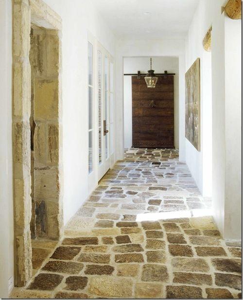 all the elements here : stone floor, barn door, lime walls... via Cote de Texas