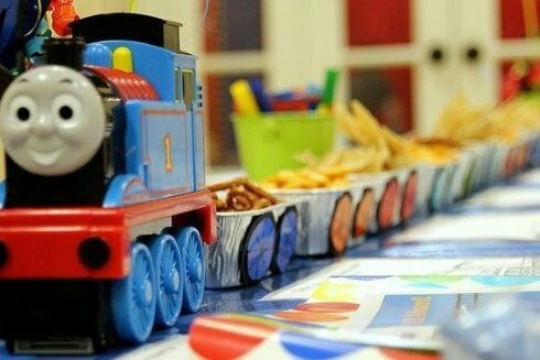 Train party: Train at the front and small containers with paper wheels attached to serve food from