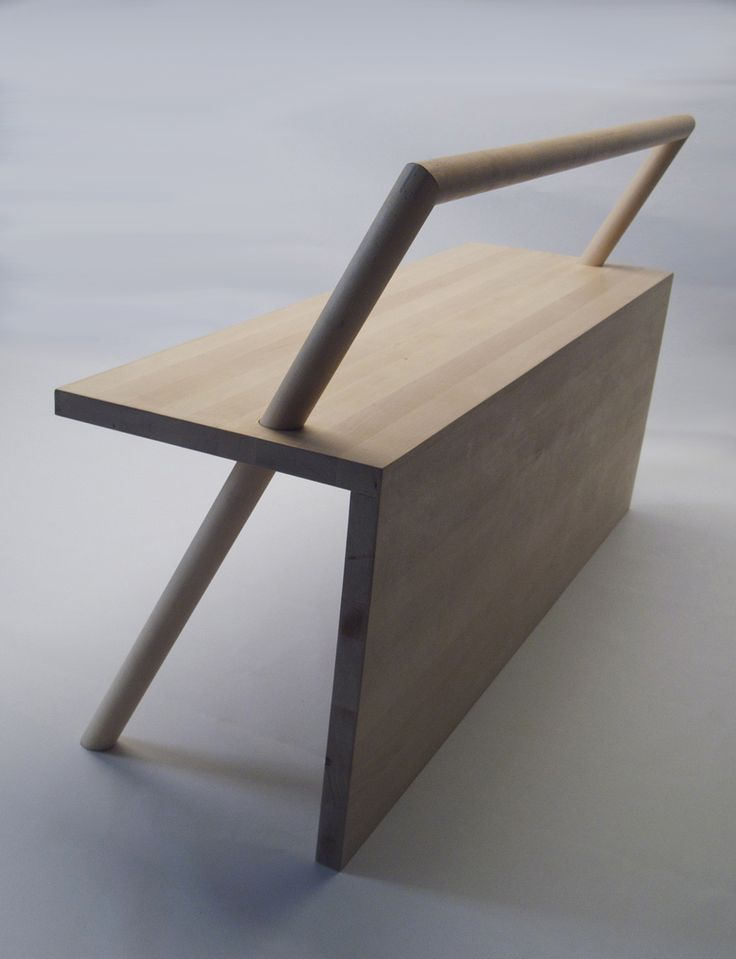 product designer Kana Nakanishi's wonderful W1200xD380xH480 Finnish birch wood bench. Named simply after its dimensions, the seat's U-shaped back rest doubles as its legs, sitting diagonally through the base.
