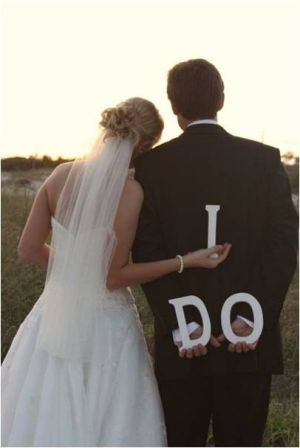 "Another Wedding photo idea I'm copycatting. Love how the pic is taken from behind and the ""I Do"" is just too perfect."