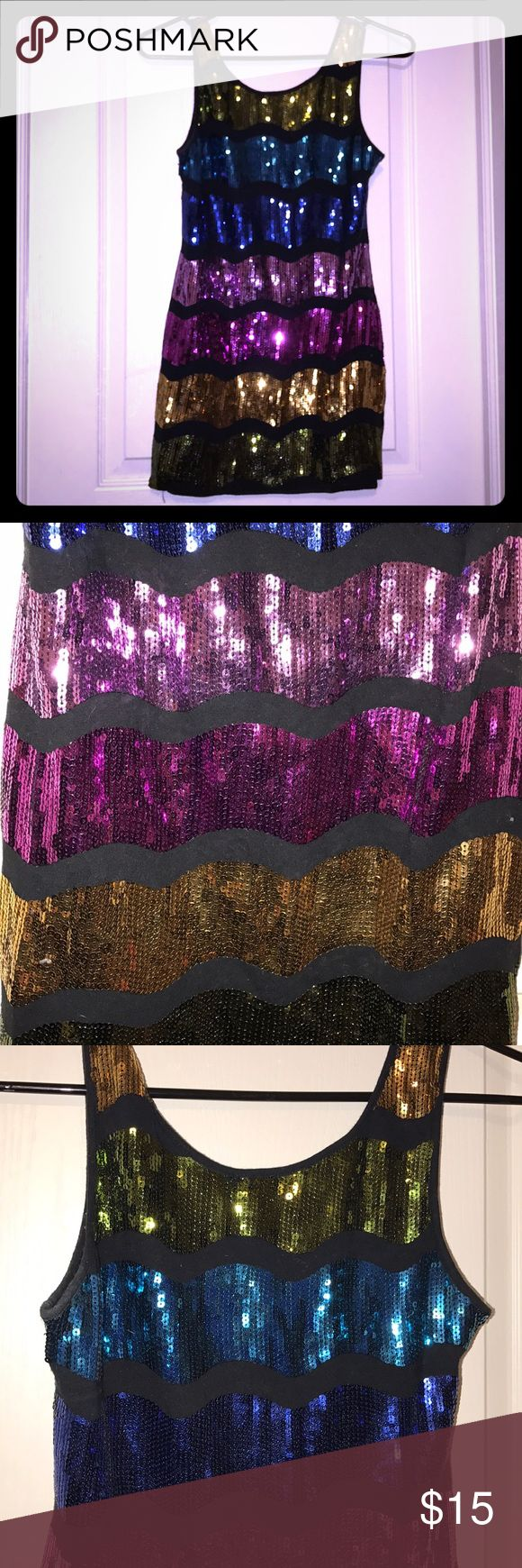 Sequin galore! Fun and festive! So sparkly! Multi colored sequined tunic! Has a couple sequins missing as shown in pic! Tops Tunics