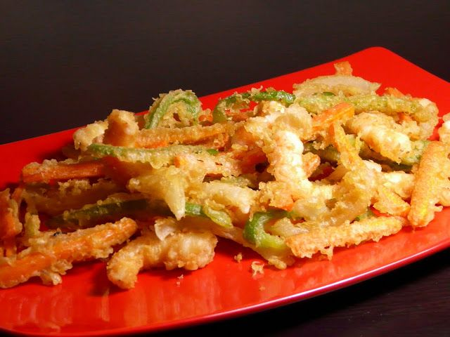 vegetables in tempura batter, verduras en tempura. These are delicious with some aioli for dipping. I usually tempura some prawns at the same time and use aubergine rather than Swiss chard. Use any peppers you want, bell peppers aren't essential!
