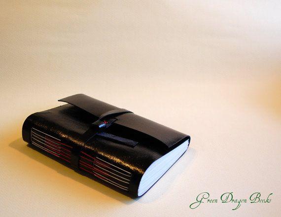 Black long stitch leather notebook