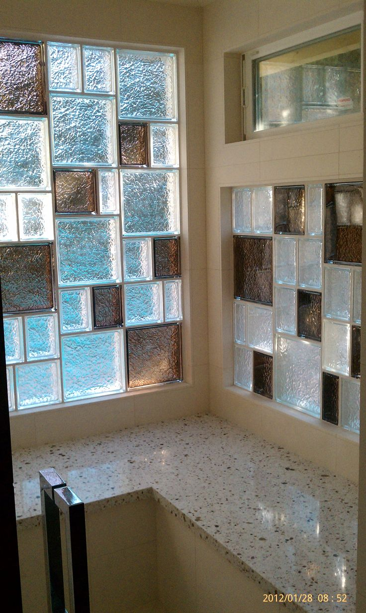 "The prefabricated vinyl framed Glass Block window also uses 6""x8"" Decora Glass Blocks to bring in light and maintain a moderate level of privacy above the large soaking tub."