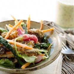 Health kale and radish slaw with medjool dates, walnuts and mustard seed dressing.