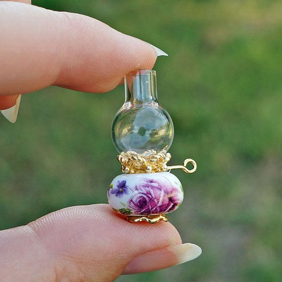 Victorian Shabby Chic Pink Roses Dollhouse Miniature Oil Lamp ... use fancy european bead with gold edges for base ... gold finding for center ... head pin with loop for 'knob' and mini glass vase for glass globe ... awesome ... I'll be making one! (all the supplies can be found in the jewelry making section at hobby lobby!)