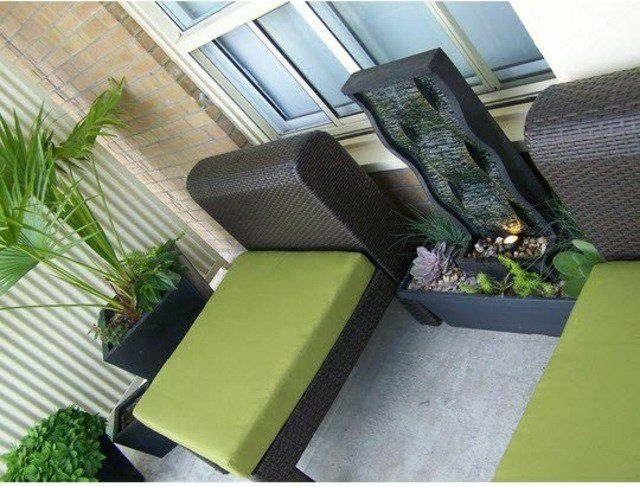 balcony water features fountain water plants mini pond ideas rattan furniture