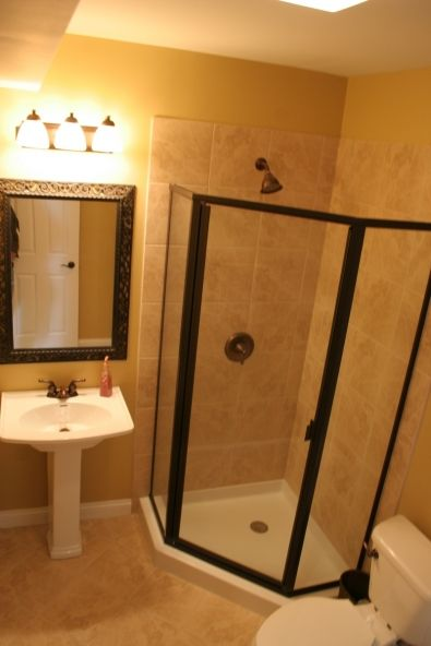 corner shower basement bathroom - this is just like our shower! :)