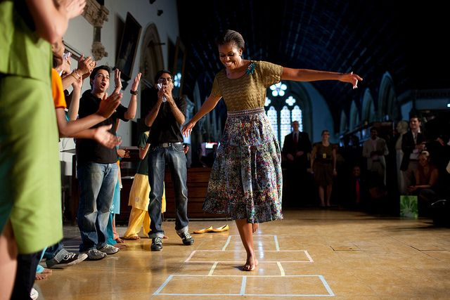 "First Lady Michelle Obama plays hopscotch during the ""Make A Difference"" program at the University of Mumbai in Mumbai, India, Nov. 6, 2010. (Official White House Photo by Chuck Kennedy)"