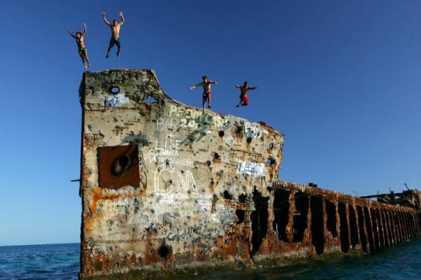 The SS Sapona was a concrete-hulled cargo steamer that ran aground near Bimini during a hurricane in 1926. The wreck of the ship is easily visible above the water, and is both a navigational landmark for boaters and a popular dive site. Our friends at Guy Harvey's Outpost – Bimini Big Game Resort