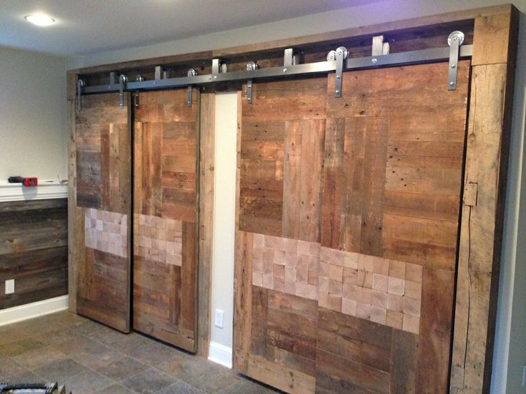Custom barn doors built from reclaimed barnwood and for Barn doors to separate rooms