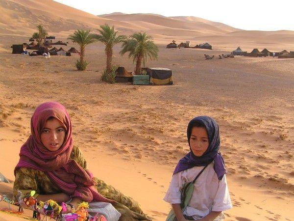 Google Image Result for http://wanderlustandlipstick.com/wp-content/uploads/2008/08/morocco_girls.jpg