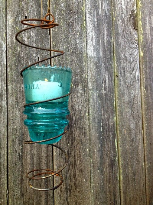 Turqoise Glass Insulator Hanging Candle Holder Wrapped in Repurposed Coil. $16.00, via Etsy.