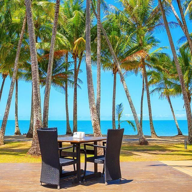 Table for two just a stones throw from the beach, now that's what I call Alfresco !!. Nu Nu Restaurant in Palm Cove - Cairns, Australia