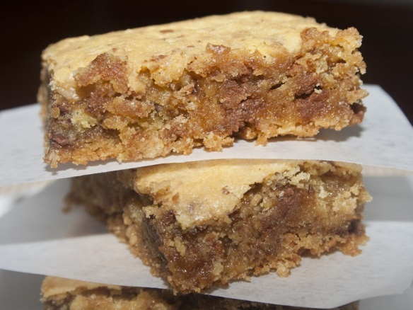 Lazy Heath Bars (4 ingredients!  yellow cake mix, butter, eggs, and a bag of those heath bar bits that are sold with the chocolate chips)