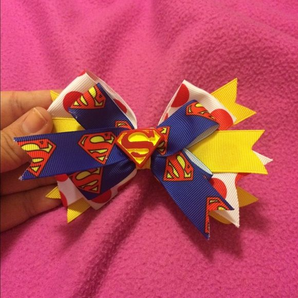 Handmade Superman hair bow Superman hair bow. Bought at a craft fair and couldn't get it to look rich in my hair. Has a clip on the back. Hand made  Accessories Hair Accessories