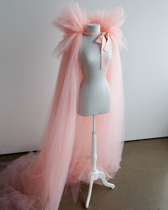 """""""Every year we try to create a costume 'story,' and Martha generally opens the story. We like to have a universal theme that appeals to both kids and adults. She knew she wanted to dress up as something 'good,' so her Fairy GrandMartha costume against the dark forest really worked,"""" says Marcie. Here, the completed fairy costume in all of its pink tulle glory."""