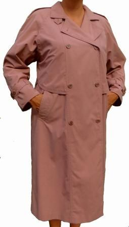A straight cut all weather in a water resistant soft summer fabric with rounded padded shoulders with no defined seams, epaulets, double breasted with a wide collar with a cream colour trim, a high neck button, two pockets plus a chest pocket that zips closed, two chest protectors and cuff ties, beautifully buttoned and finished back vent,